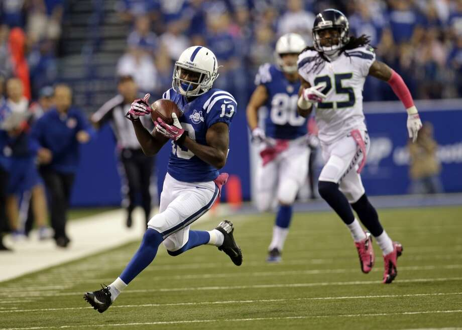 Indianapolis Colts wide receiver T.Y. Hilton, left, makes a catch in front of Seattle Seahawks cornerback Richard Sherman on his way to the end zone for a touchdown during the first half of an NFL football game in Indianapolis, Sunday, Oct. 6, 2013. (AP Photo/AJ Mast) Photo: AJ Mast, AP