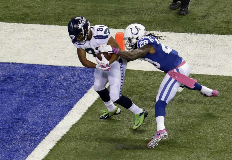 Seattle Seahawks wide receiver Golden Tate, left, breaks the tackle of Indianapolis Colts cornerback Greg Toler to score a touchdown during the first half of an NFL football game in Indianapolis, Sunday, Oct. 6, 2013. (AP Photo/AJ Mast) Photo: AJ Mast, ASSOCIATED PRESS