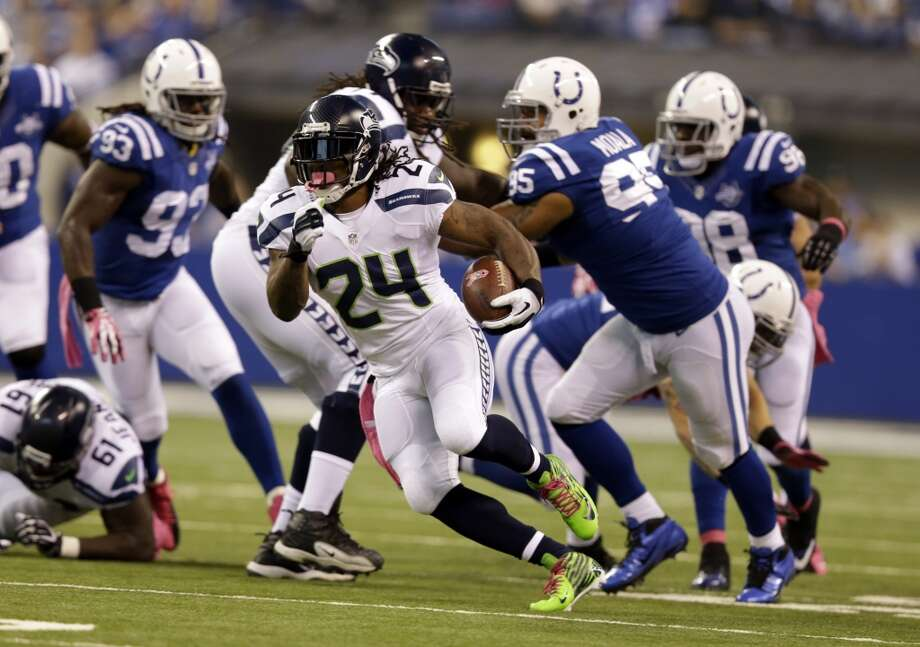 Seattle Seahawks running back Marshawn Lynch breaks through the Indianapolis Colts defense for a gain during the first half of an NFL football game in Indianapolis, Sunday, Oct. 6, 2013. (AP Photo/Michael Conroy) Photo: Michael Conroy, AP