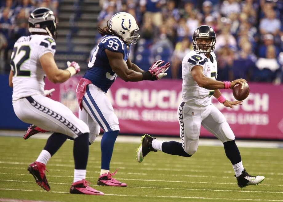 Seattle Seahawks quarterback Russell Wilson, right, throws to tight end Luke Willson, left, in front of Indianapolis Colts outside linebacker Erik Walden during the first half of an NFL football game in Indianapolis, Sunday, Oct. 6, 2013. (AP Photo/Brent R. Smith) Photo: Brent R. Smith, AP