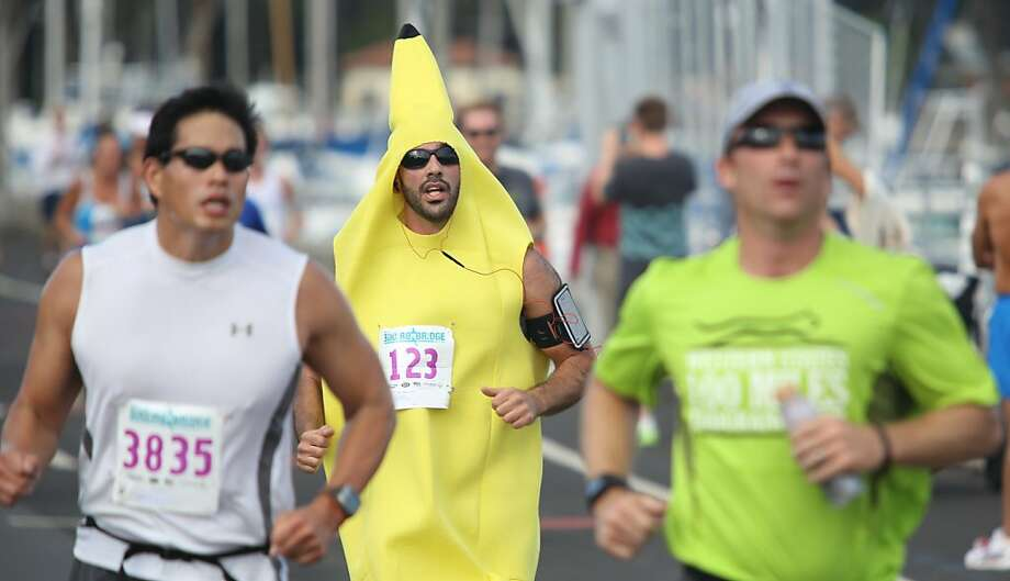 A runner dressed as a banana is among about 4,000 people competing in the Bridge to Bridge race in San Francisco. Photo: Mathew Sumner, Special To The Chronicle