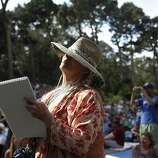 Ann Cohen sketches as the Tumbleweed Wanderers play at the Rooster Stage at Hardly Strictly Bluegrass in Golden Gate Park on Sunday, Oct. 7, 2013. Hardly Strictly Bluegrass is an annual concert that takes place in Golden Gate Park.