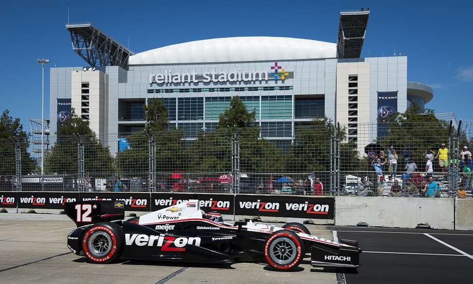 Will Power drives past the Reliant Stadium during Sunday's race. Power held off Scott Dixon to win the event. (Smiley N. Pool/Houston Chronicle) Photo: Smiley N. Pool, Houston Chronicle