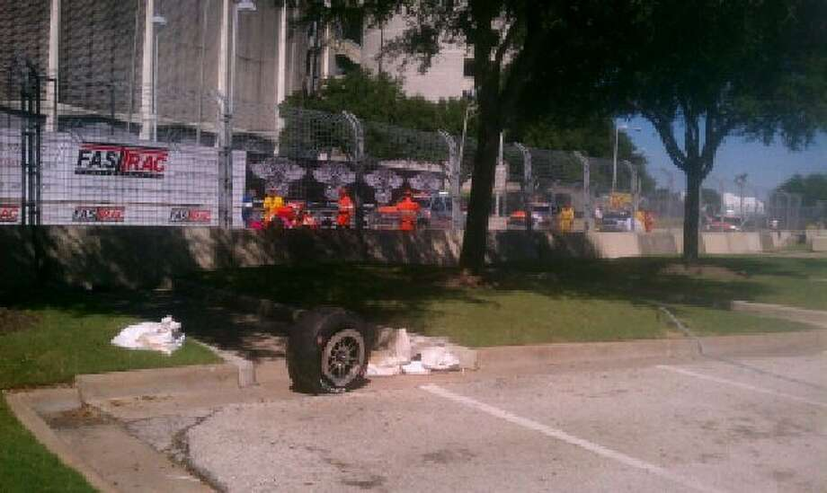 A tire that bounced off the track and hit the fencing sits on the Reliant Center pavement. Photo: Photo Courtesy Of Robert Garcia