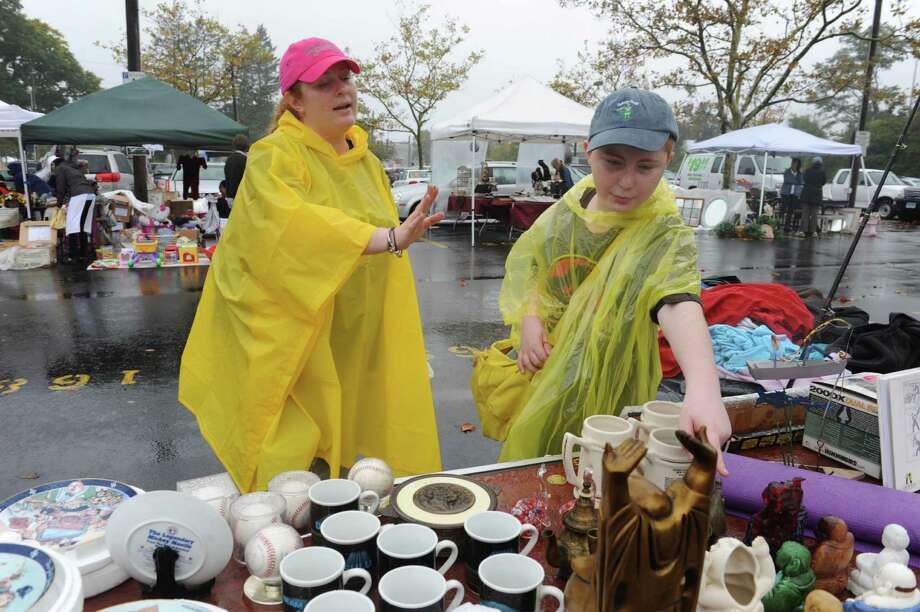 Dorianne Pisanelli, of Stamford, and Zach, 12, shop at Greenwich Knights of Columbus's Annual flea market at Island Beach parking lot, in Greenwich, Conn., Sunday, Oct. 6, 2013. Photo: Helen Neafsey / Greenwich Time