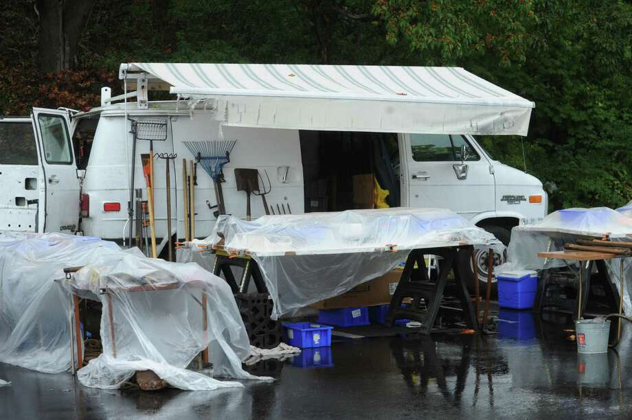 Most things are wet at Greenwich Knights of Columbus's Annual flea market at Island Beach parking lot, in Greenwich, Conn., Sunday, Oct. 6, 2013. Photo: Helen Neafsey / Greenwich Time