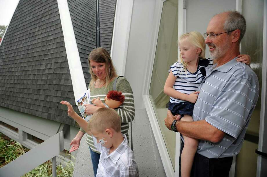 "From left, Christian Copeland, 8, Ginny, Lilly, 5, and Ken waiting for the celebration at West Norwalk United Congregational Church's ""Renovations Celebration,"" Norwalk, Conn., Sunday, Oct. 6, 2013. Photo: Helen Neafsey / Greenwich Time"