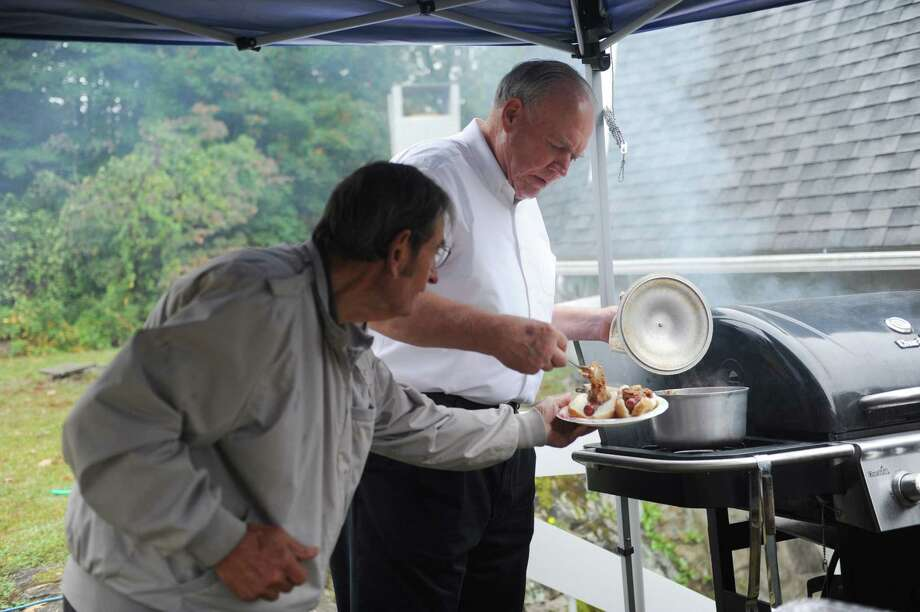 "Bob Kish and Chet Hatch making franks at West Norwalk United Congregational Church's ""Renovations Celebration,"" in Norwalk, Conn., Sunday, Oct. 6, 2013. Photo: Helen Neafsey / Greenwich Time"