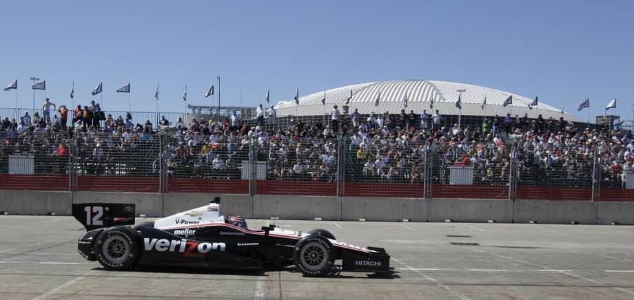 The AstroDome is shown in background as Will Power competes in the second race. Photo: Melissa Phillip, Houston Chronicle