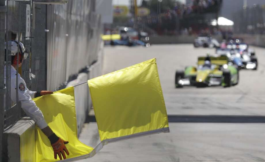 A yellow flag is shown during the second race on Sunday. Photo: Melissa Phillip, Houston Chronicle