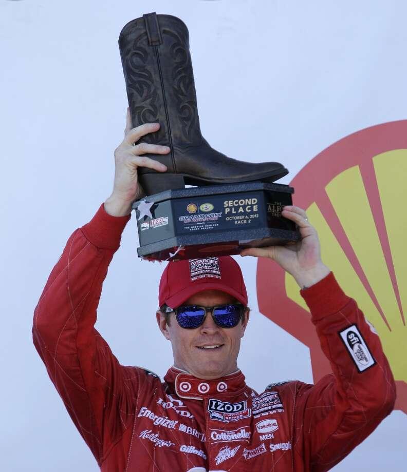Scott Dixon holds his second place trophy after the second race. Photo: Melissa Phillip, Houston Chronicle