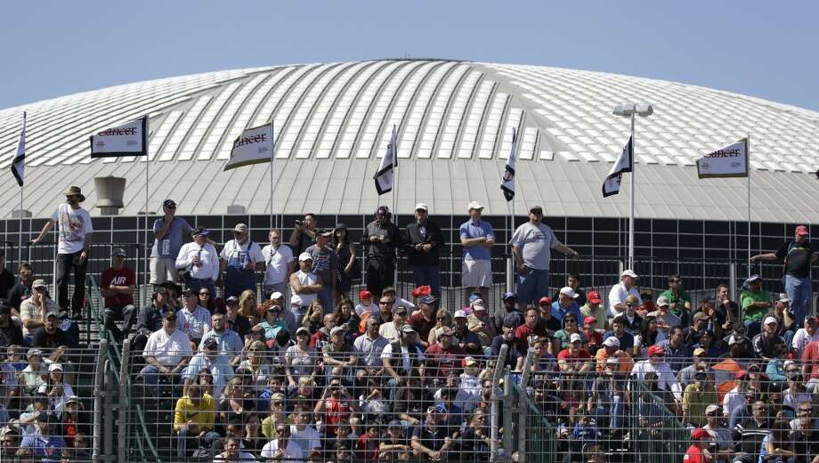 The Astrodome is shown in background as fans watch the second race of the Shell and Pennzoil Grand Prix of Houston at Reliant Park on Sunday. Photo: Melissa Phillip, Houston Chronicle