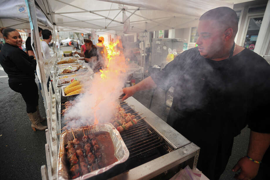 Luis Negron of Paradise Island Deli & Cafe in Stratford cooks Puerto Rican and Spanish specialties at Shelton Day on Howe Avenue in downtown Shelton, Conn. on Sunday, October 6, 2013. Photo: Brian A. Pounds / Connecticut Post