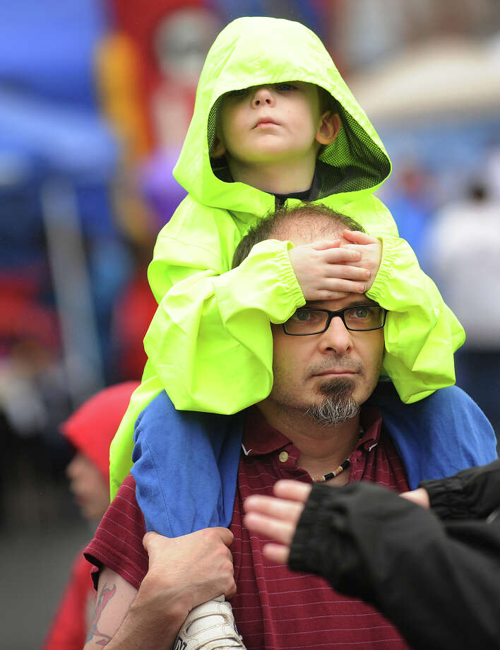 Sean Ahern and his son Logan, 3, of Shelton, enjoy Shelton Day festivities in spite of a misty rain on Howe Avenue in downtown Shelton, Conn. on Sunday, October 6, 2013. Photo: Brian A. Pounds / Connecticut Post