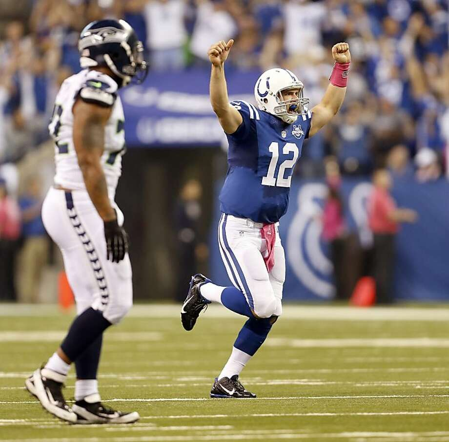 Indianapolis quarterback Andrew Luck celebrates after his 29-yard touchdown pass to T.Y. Hilton - his second TD pass to him in the game - in the third quarter. Photo: Sam Riche, McClatchy-Tribune News Service