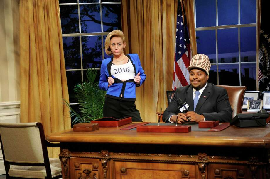 "This Oct. 5, 2013 photo released by NBC shows guest host Miley Cyrus, left, and  Kenan Thompson in a scene from the late-night comedy series ""Saturday Night Live,"" in New York. Photo: AP"