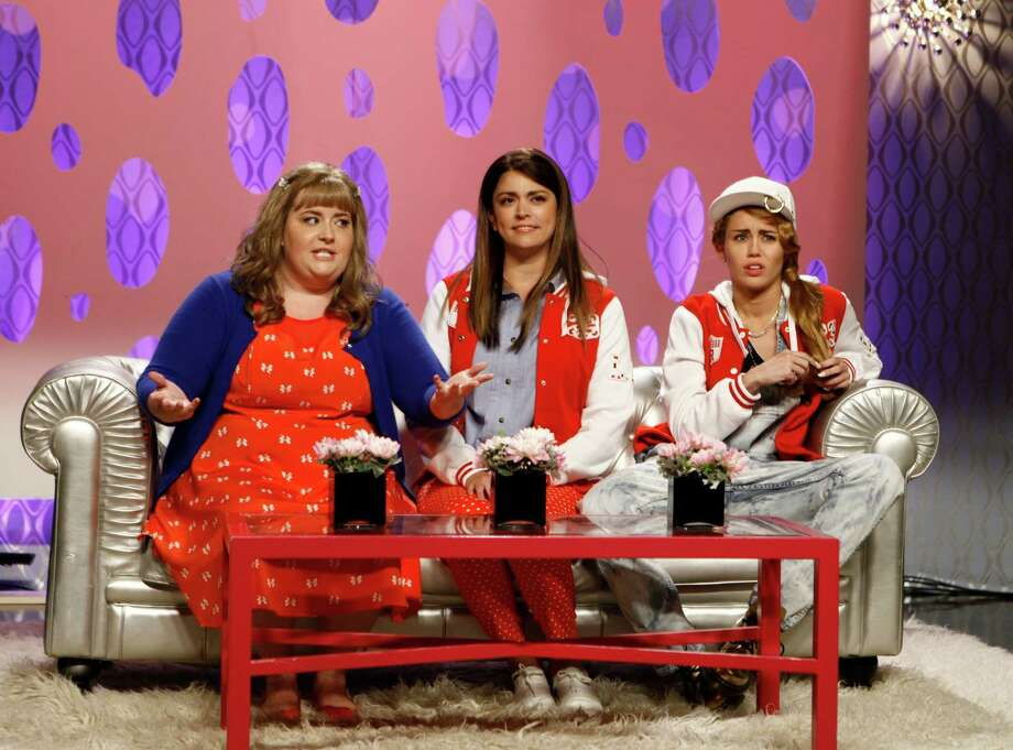 "This Oct. 5, 2013 photo released by NBC shows, from left, Aidy Bryant, Cecily Strong, and guest host Miley Cyrus in a scene from the late-night comedy series ""Saturday Night Live,"" in New York. Photo: AP"
