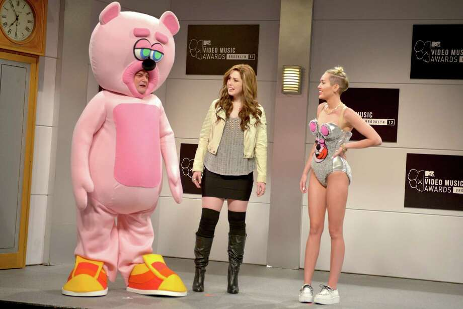 "This Oct. 5, 2013 photo released by NBC shows, from left,  Bobby Moynihan, Vanessa Bayer and guest host Miley Cyrus in a scene from the late-night comedy series ""Saturday Night Live,"" in New York. Photo: AP"