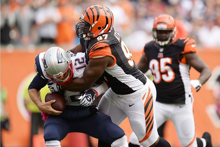 Geno Atkins of the Bengals tackles Patriots quarterback Tom Brady in the first quarter, one of four Cincinnati sacks. Photo: Jamie Sabau, Getty Images