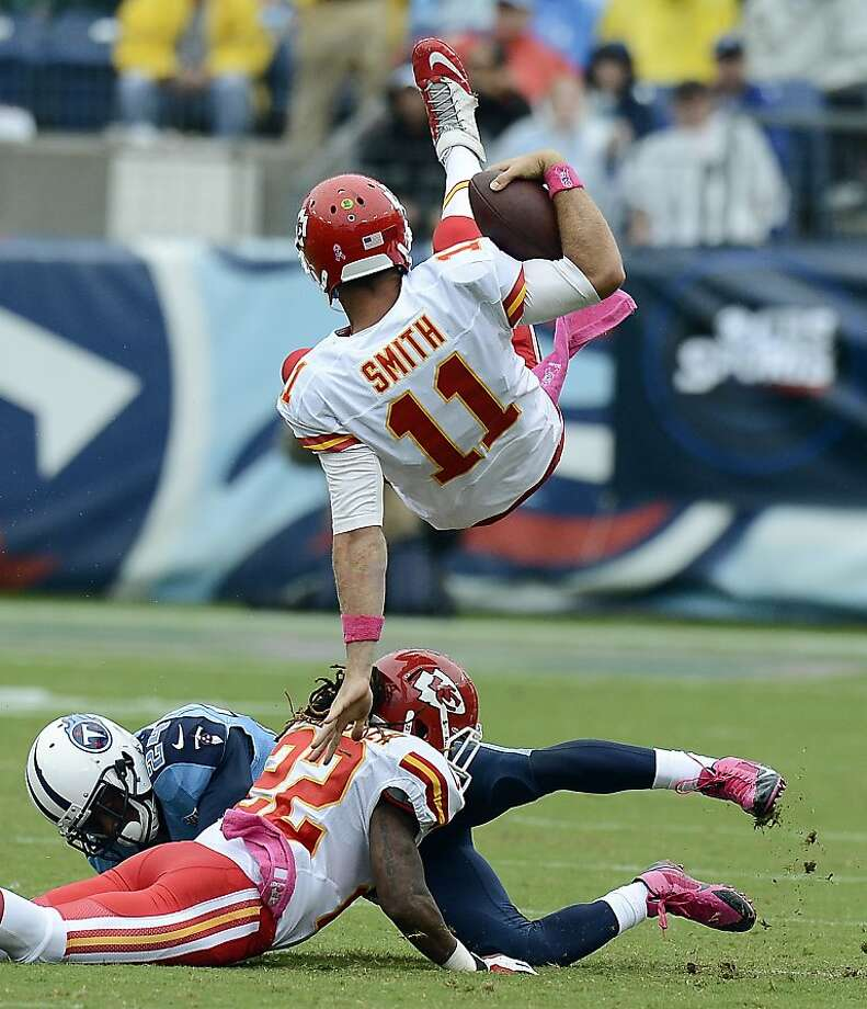 Kansas City quarterback Alex Smith is upended, but his team was not and is 5-0. Photo: Mark Zaleski, Associated Press