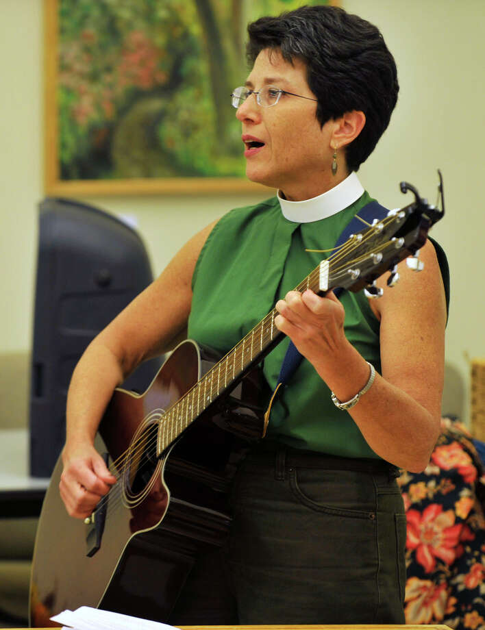 Rev Kate Heichler plays the guitar and sings during the Blessing of Animals ceremony at the Bartlett Arboretum and Gardens in Stamford, Conn. on Sunday, Oct. 6, 2013. Photo: Jason Rearick / Stamford Advocate