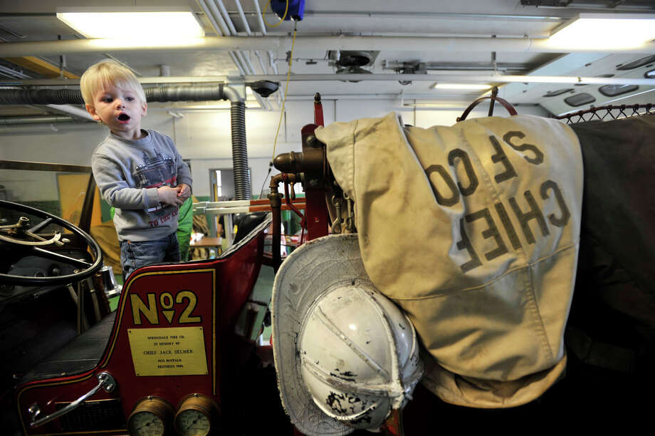 Aaron Franco stands in the drivers seat of a 1933 Buffalo fire engine during the open house at the Springdale fire station in Stamford, Conn., on Sunday, Oct. 6, 2013. The Buffalo fire engine was the second engine ever used at the Springdale station. Photo: Jason Rearick / Stamford Advocate