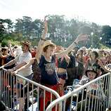 Mindell Hiley throws her hands up during a set by The Brothers Comatose at the Arrow Stage in Golden Gate Park during the Hardly Strictly Bluegrass festival on Sunday, Oct. 7, 2013. Hardly Strictly Bluegrass is an annual concert that takes place in Golden Gate Park.