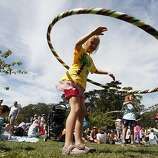 Malea Smith, center, hula hoops at Hardly Strictly Bluegrass in Golden Gate Park on Sunday, Oct. 7, 2013. Hardly Strictly Bluegrass is an annual concert that takes place in Golden Gate Park.