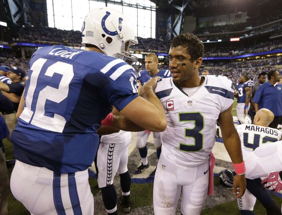 Indianapolis Colts quarterback Andrew Luck, left, meets with Seattle Seahawks quarterback Russell Wilson following an NFL football game in Indianapolis, Sunday, Oct. 6, 2013. The Colts defeated the Seahawks 34-28. (AP Photo/Michael Conroy) Photo: Michael Conroy, AP