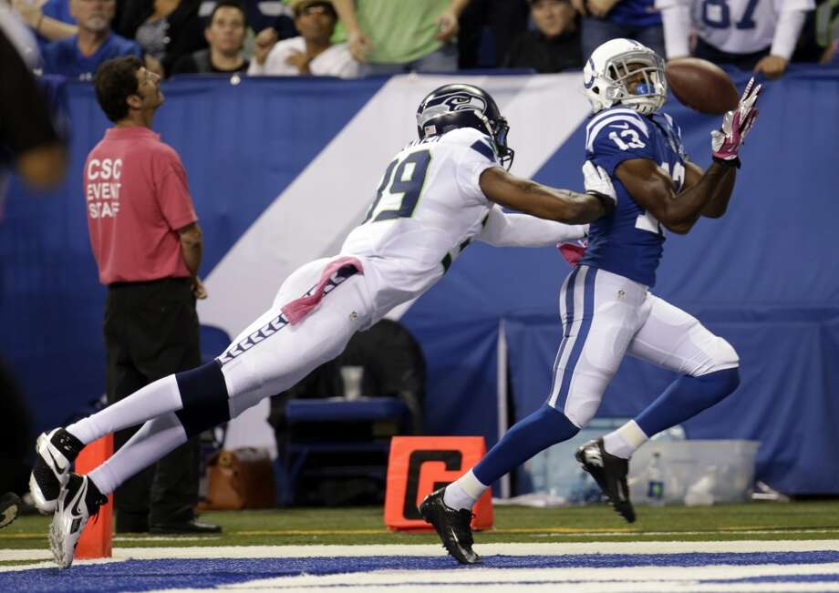 Indianapolis Colts wide receiver T.Y. Hilton, right, makes a catch for a touchdown in front of Seattle Seahawks cornerback Brandon Browner during the second half of an NFL football game in Indianapolis, Sunday, Oct. 6, 2013. (AP Photo/AJ Mast) Photo: AJ Mast, AP