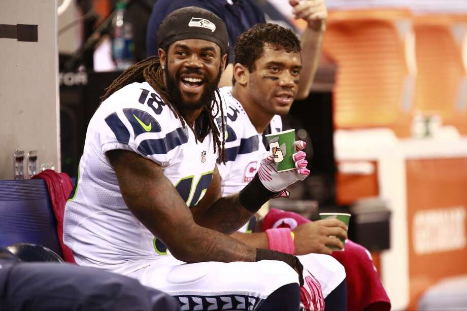 Seattle Seahawks wide receiver Sidney Rice and quarterback Russell Wilson on the bench during the second half of an NFL football game against the Indianapolis Colts in Indianapolis, Sunday, Oct. 6, 2013. (AP Photo/Brent R. Smith) Photo: Brent R. Smith, AP