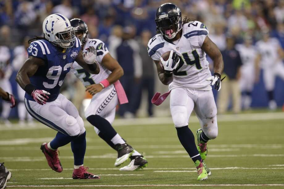 Seattle Seahawks running back Marshawn Lynch, right, is chased by Indianapolis Colts outside linebacker Erik Walden during the second half of an NFL football game in Indianapolis, Sunday, Oct. 6, 2013. (AP Photo/AJ Mast) Photo: AJ Mast, AP