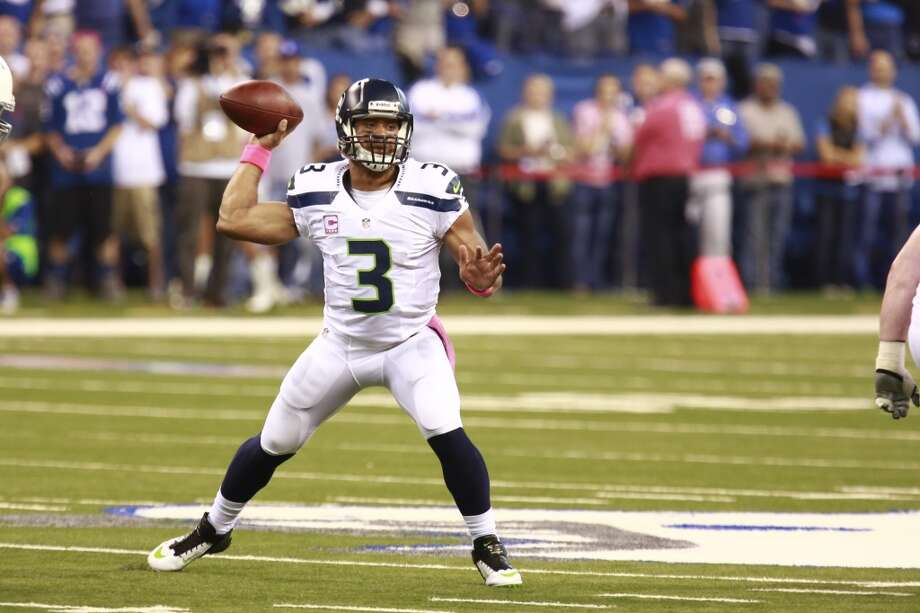 Seattle Seahawks quarterback Russell Wilson throws against the Indianapolis Colts during the first half of an NFL football game in Indianapolis, Sunday, Oct. 6, 2013. (AP Photo/Brent R. Smith) Photo: Brent R. Smith, AP