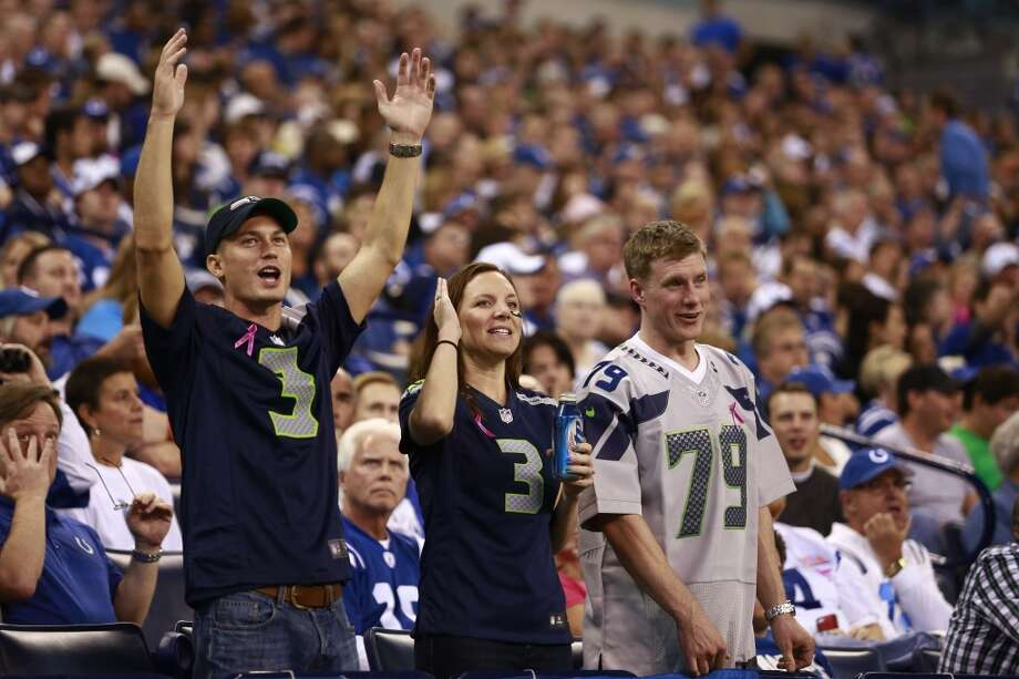 Seattle Seahawks fans celebrate during the first half of an NFL football game against the Indianapolis Colts in Indianapolis, Sunday, Oct. 6, 2013. (AP Photo/Brent R. Smith) Photo: Brent R. Smith, AP