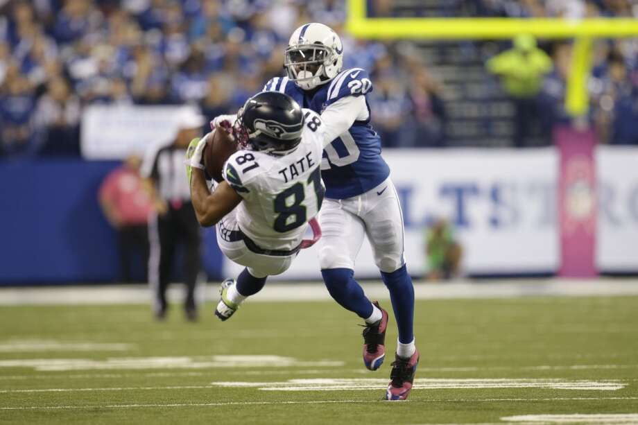 Seattle Seahawks wide receiver Golden Tate, left, makes a catch over Indianapolis Colts cornerback Darius Butler during the first half of an NFL football game in Indianapolis, Sunday, Oct. 6, 2013. Tate was called for pass interference on the play. (AP Photo/AJ Mast)