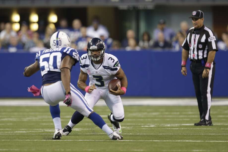 Seattle Seahawks quarterback Russell Wilson, right, is chafed by Indianapolis Colts inside linebacker Jerrell Freeman during the first half of an NFL football game in Indianapolis, Sunday, Oct. 6, 2013. (AP Photo/AJ Mast) Photo: AJ Mast, AP