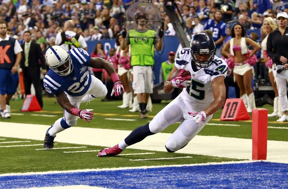 Seattle Seahawks wide receiver Jermaine Kearse, right, scores a touchdown on a catch in front of Indianapolis Colts cornerback Vontae Davis during the first half of an NFL football game in Indianapolis, Sunday, Oct. 6, 2013. (AP Photo/Brent R. Smith) Photo: Brent R. Smith, ASSOCIATED PRESS