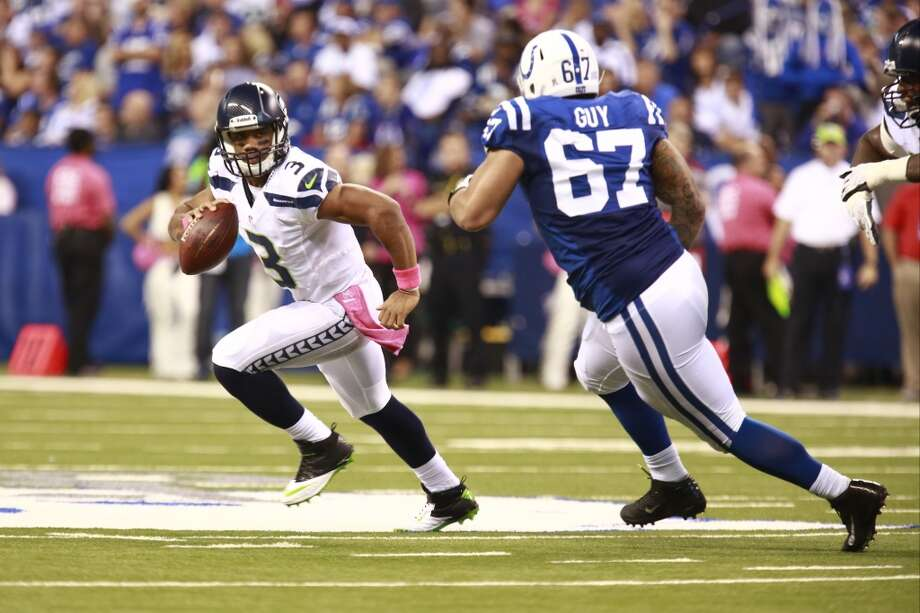 Indianapolis Colts defensive tackle Lawrence Guy, right, chases Seattle Seahawks quarterback Russell Wilson during the second half of an NFL football game in Indianapolis, Sunday, Oct. 6, 2013. (AP Photo/Brent R. Smith) Photo: AP