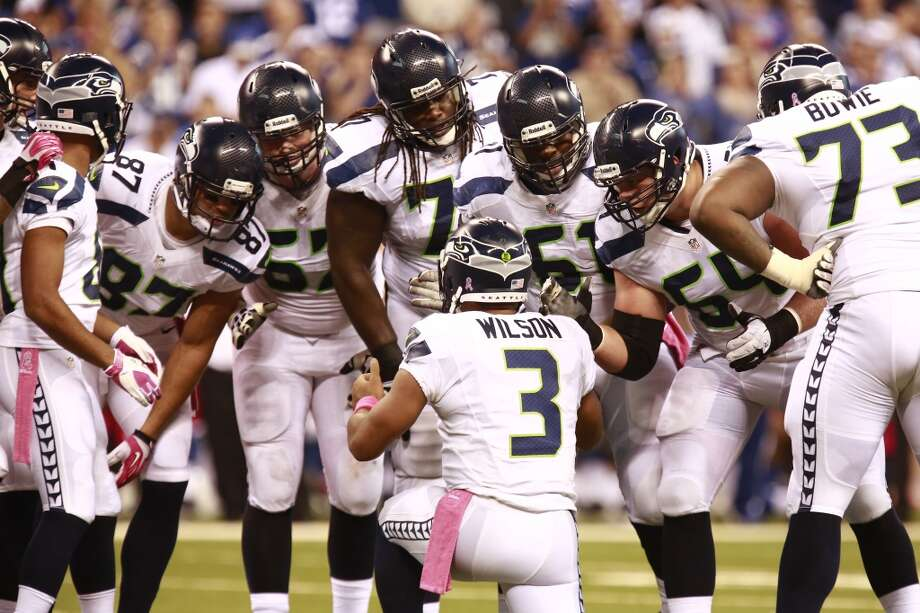 Seattle Seahawks quarterback Russell Wilson calls a play in the huddle during the second half of an NFL football game against the Indianapolis Colts in Indianapolis, Sunday, Oct. 6, 2013. (AP Photo/Brent R. Smith) Photo: AP