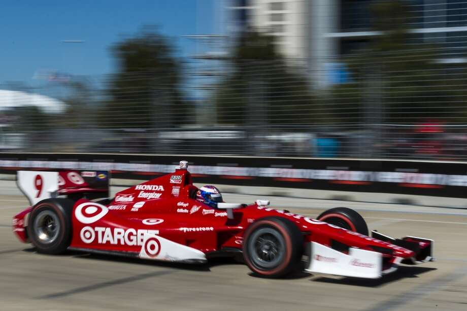 Scott Dixon races past Reliant Stadium. Photo: Smiley N. Pool, Houston Chronicle
