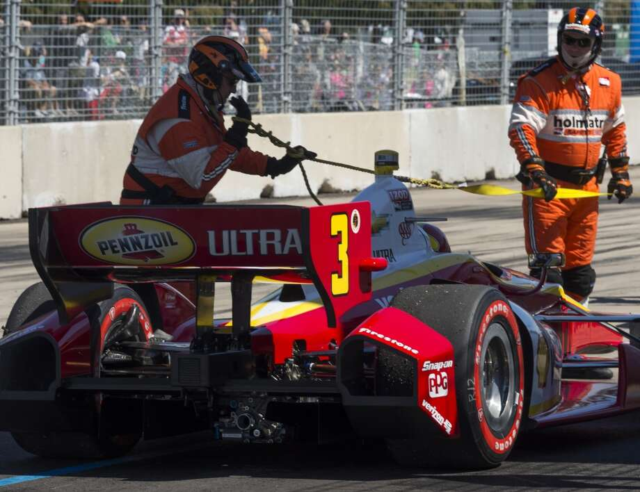 Helio Castroneves prepares to be towed off the track during the second race. Photo: Smiley N. Pool, Houston Chronicle