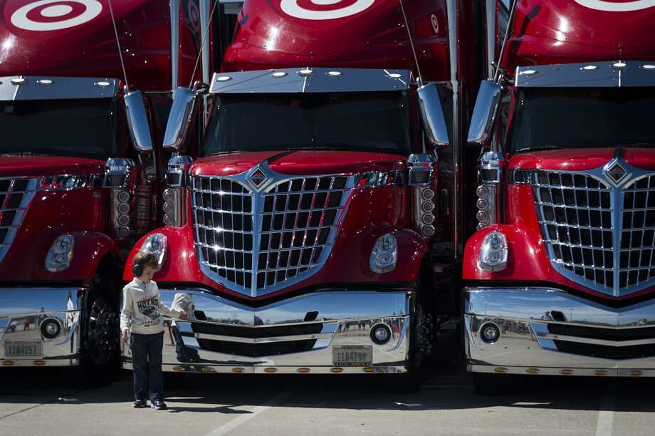A young fan checks out a row of trucks during the second race. Photo: Smiley N. Pool, Houston Chronicle