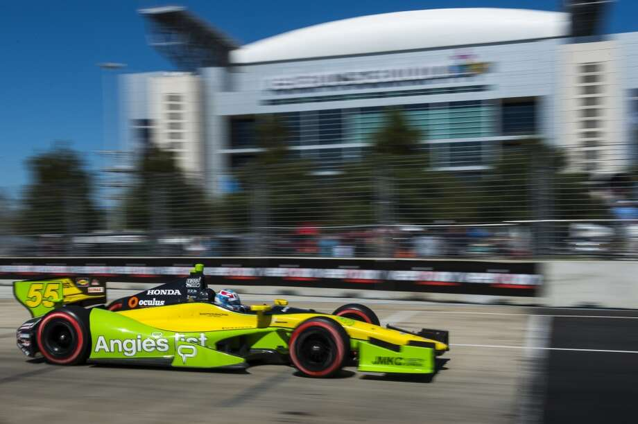 Tristan Vautier races past Reliant Stadium during the second race. Photo: Smiley N. Pool, Houston Chronicle