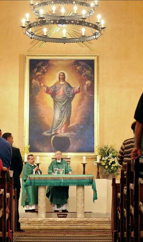 Deacon Ray Jimenez (left) and Father David Garcia lead mass in the church at Mission Concepcion Sunday Oct. 6, 2013. Photo: Edward A. Ornelas, San Antonio Express-News / © 2013 San Antonio Express-News