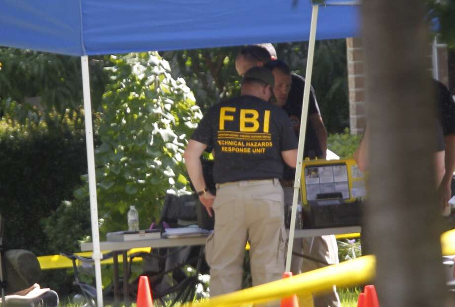 Law enforcement officers are searching a home near Rice Village Friday morning, officials said. The search warrant is being executed at the house in the 2000 block of Albans Photo: Johnny Hanson, Houston Chronicle