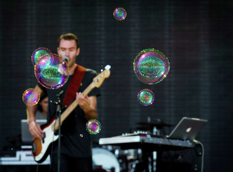 Bubbles float by as Bear Mountain performs at the Austin City Limits Music Festival at Zilker Park in Austin, Texas, on Sunday Oct. 6, 2013.   Photo: Jay Janner, Associated Press / Austin American-Statesman
