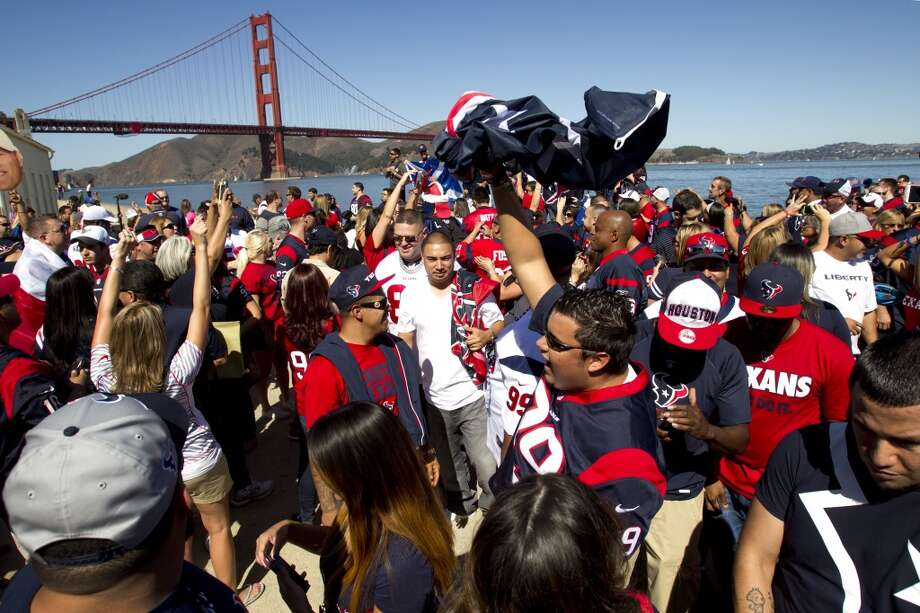 Texans fans cheer as they gather near the Golden Gate Bridge Photo: Brett Coomer, Houston Chronicle