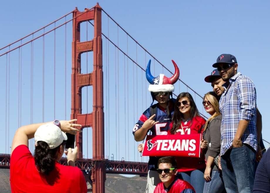 Texans fans gather near the Golden Gate Bridge. Photo: Brett Coomer, Houston Chronicle