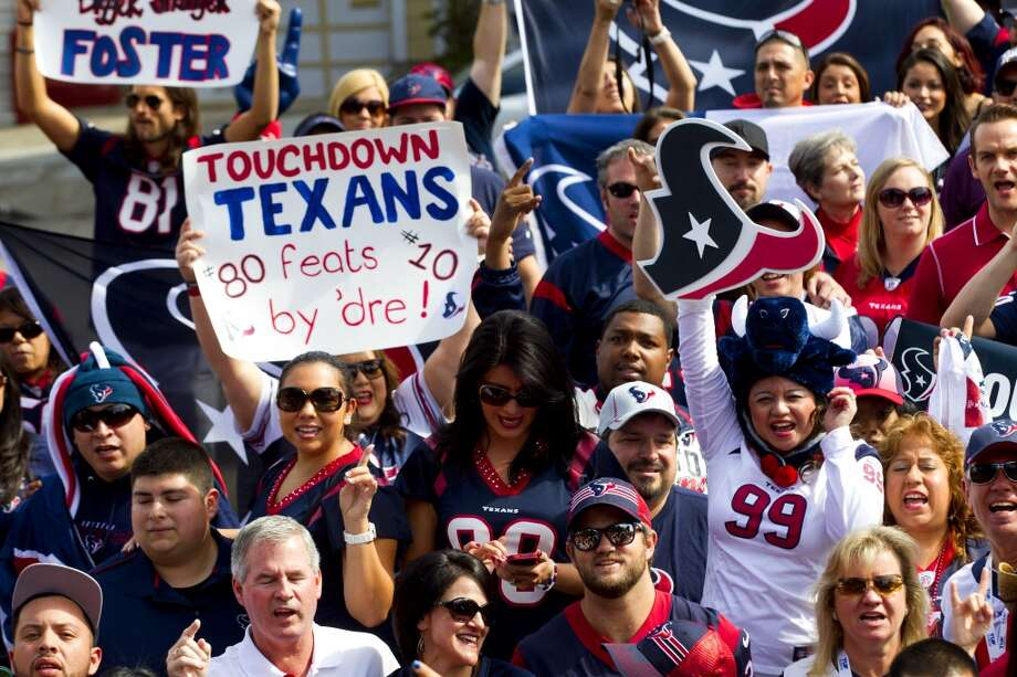 Texans fans cheer as they gather for a group photo near the Painted Ladies. Photo: Brett Coomer, Houston Chronicle