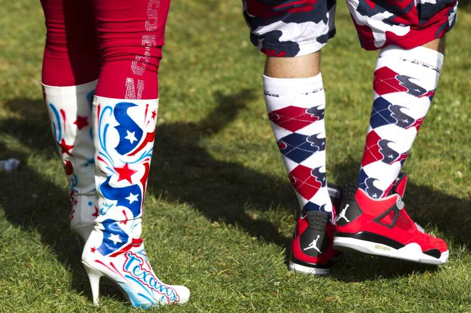 Fans show off their Texans-themed footwear. Photo: Brett Coomer, Houston Chronicle